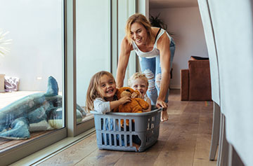 Mom and kids enjoying home after professional cleaning service
